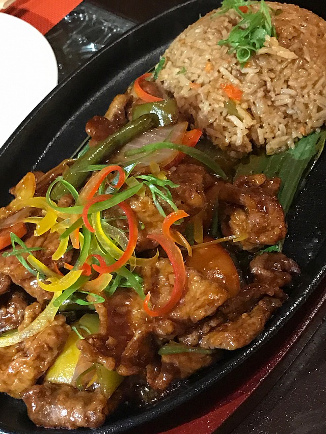 Their signature dish, beef sizzling with a side of fried rice