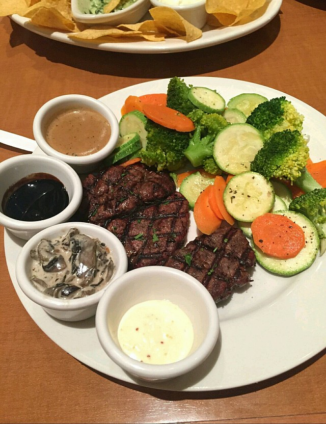 Steak with all the suaces
