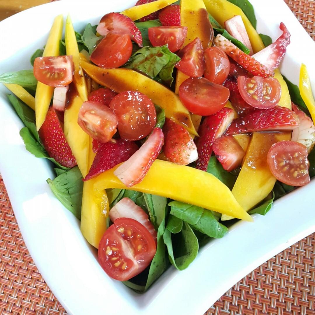 gargeer fusion #salad  + Pomegranate souce #Strawberry #Mango#gargeer #tomato @ Veranda Cafe - Bahrain