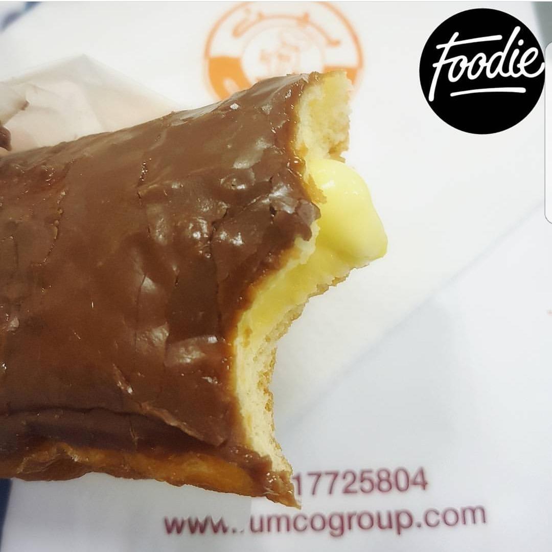 Chocolate glazed custard filled donuts � @ Bait Al Donut - Bahrain