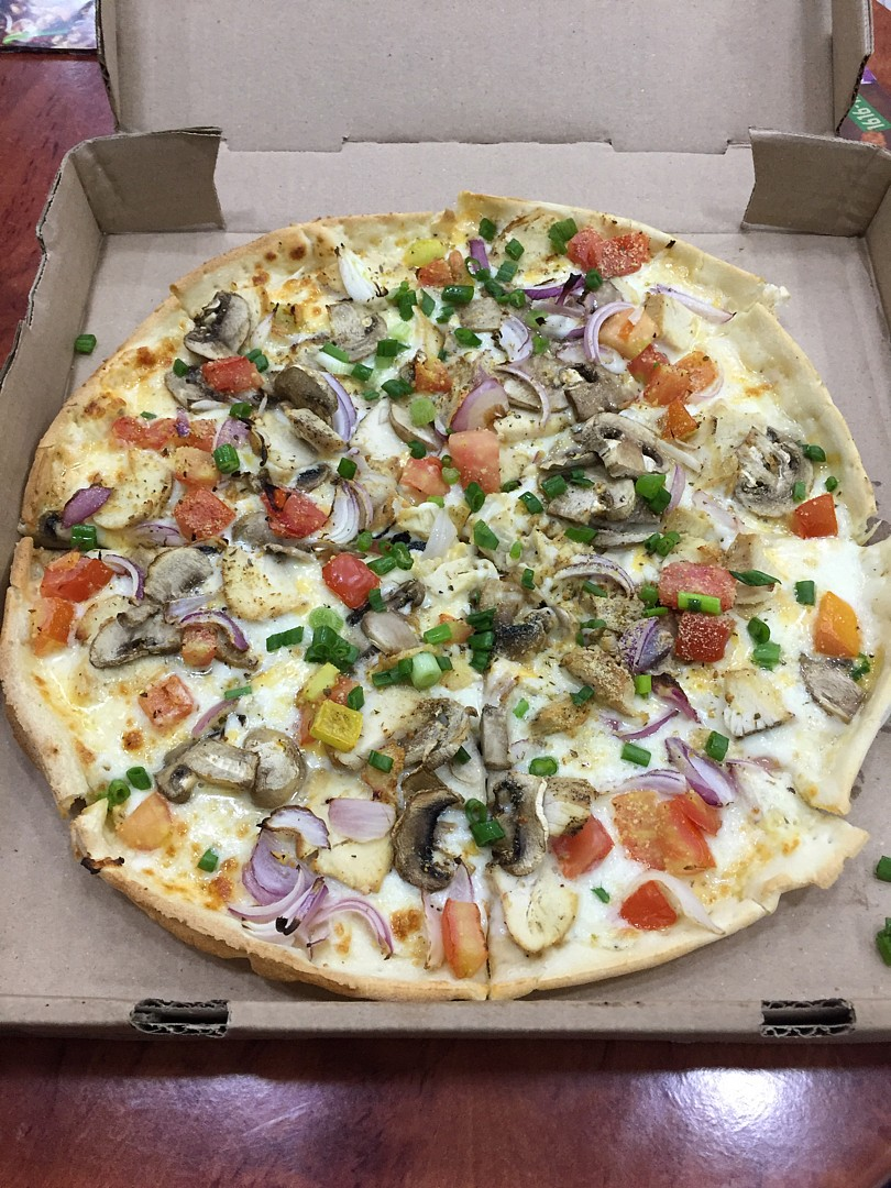 Amazing Skinny pizza � @ Round Table Pizza - Bahrain