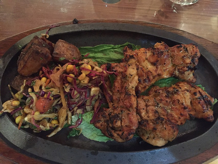 Grilled chicken fillet sizzling